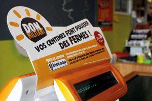 affichage caisse magasin opération don militant